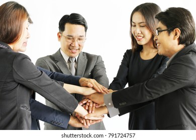 Successful teamwork : Young business people team up with a smile : Teams of business men and women team up for success. Selective Focus