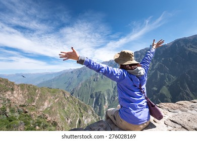 Successful Traveler to hiking to summit and bird watching, Colca Canyon, Arequipa, Peru