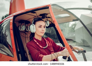 Successful woman. Successful beautiful businesswoman sitting in her little modern helicopter