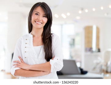 Successful woman owning a hair salon and looking very happy