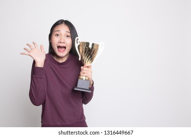 Successful young asian woman holding a trophy on white background
