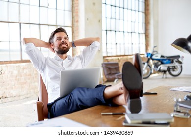 Successful young business man in loft office