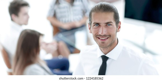 successful young business men on blurred background