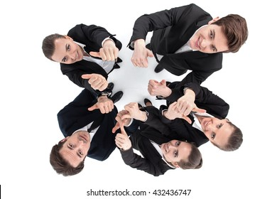 Successful young business people showing thumbs up sign isolated on white background