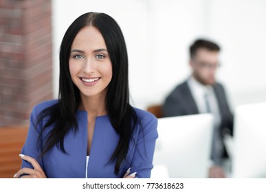 Successful young business woman with charming confident smile