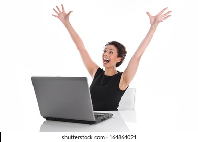 Successful young business woman at desk with computer - Stock Photo
