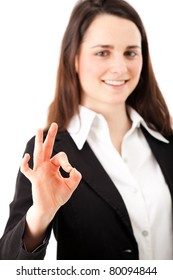 Successful young business woman doing the ok sign