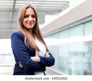 Successful young business woman looking confident and smiling