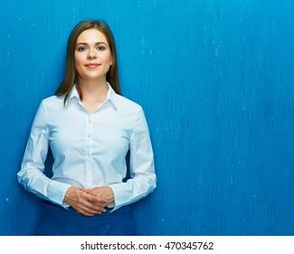 Successful young business woman portrait. White shirt. Long hair.