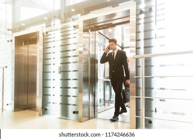 successful and young businessman in the elevator business center rides to work
