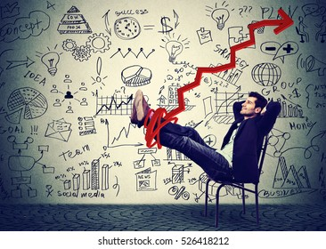 Successful young businessman executive relaxing sitting on a chair in the office