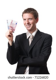 successful young businessman holding banknotes isolated on white background