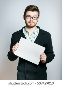 successful young businessman holding a white banner, stylish Manager closeup