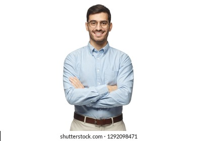 Successful young businessman standing with crossed arms isolated on white background