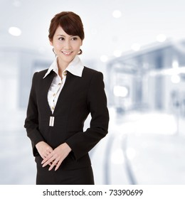 Successful young executive woman smiling, closeup portrait in office.