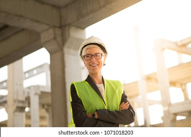 A successful young female engineer, proud and satisfied with the completed job.