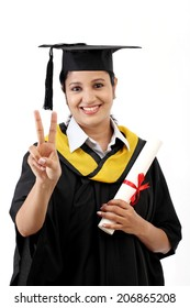 Successful young female graduate against white background