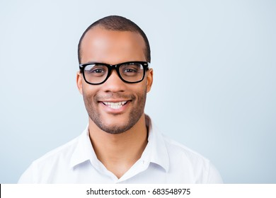 Successful young handsome mulatto american student in formal outfit and black glasses on pure background. So cheerful and stylish, attractive and smart