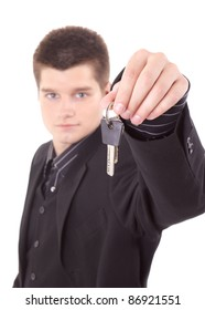 successful, young man holds the key to your home