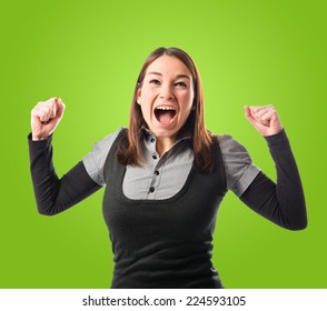 Successful young pretty woman over green background