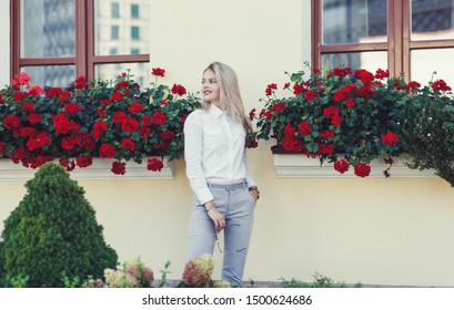 successful young woman in formal wear in the city