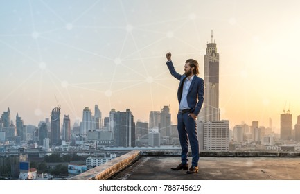 Successfull business in suit on rooftop with city scape in the background with connecting dots