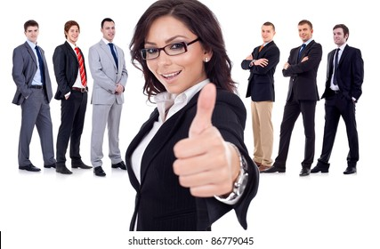 Successfull business woman givinng thumbs up for his team