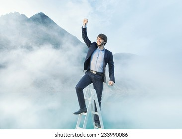Successfull businessman reaching the top