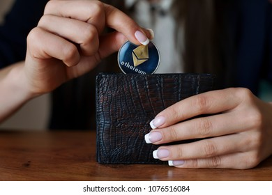 Successfully woman put an ethereum into wallet. ETH Crypto coin saving. Savings money. Blockchain technology. Ethereum cryptocurrency, market platform