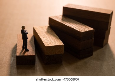 Successive business concept.Businessmen thinking on first step of wood stair.