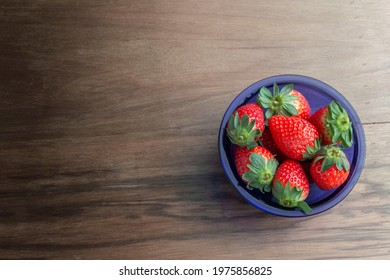 Succulent fresh strawberries in a glaass blue bowl