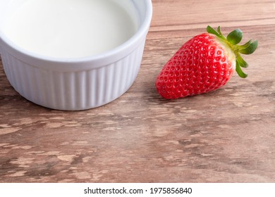 Succulent fresh strawberries in a white plate