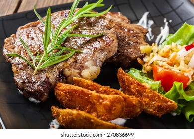 Succulent portion of beef steak served with roast potatoes