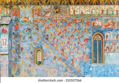 SUCEVITA, ROMANIA - AUGUST 08, 2015 - The Ladder of Divine Ascent, or Ladder of Paradise shows how to raise one's soul and body to God, painted on a wall of Sucevita Monastery in Moldavia, Romania.