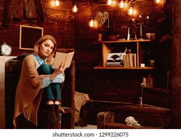 Such an interesting book. Woman student enjoy reading literacy. Pretty woman read a book. Knowledge and reading comprehension are keys to literacy. Student get knowledge from book.