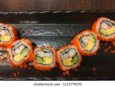 Suchi roll on tray black.