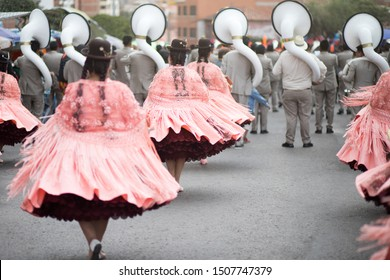 Sucre, Bolivia: Annual celebration parade in devotion of the Virgin of Guadalupe by fraternities with traditional Bolivian native dances and costumes and band music, cholita dress dancers