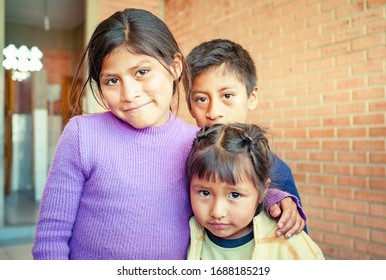 Sucre, Chuquisaca / Bolivia - November 24 2016: Young Indigenous Quechua Girls and Boy Outside of the Primary School Class