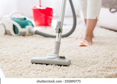 Suction grey carpet cleaning with vacuum cleaner