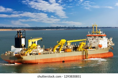 Suction hopper dredger vessel at work.