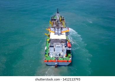 Suction-Dredger vessel at sea, Aerial image.