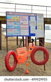 SUDAK, CRIMEA - 18 SEPTEMBER 2016: Rescue equipment on the beach - circle vest, the rules of conduct.