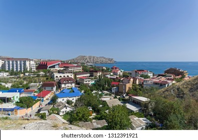 Sudak, Crimea - September 3, 2017: View of the eastern part of the resort town of Sudak from the Genoese fortress. A sunny day in early September. Crimea.