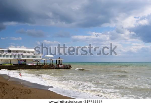"SUDAK, RUSSIA  - SEPTEMBER 24, 2014:  Black sea coast, sea surf, view hotel ""Brigantina"""