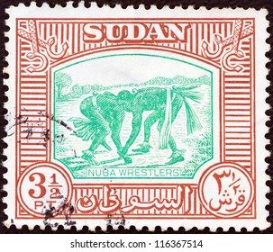 SUDAN - CIRCA 1951: A stamp printed in Sudan shows Nuba wrestlers, circa 1951.