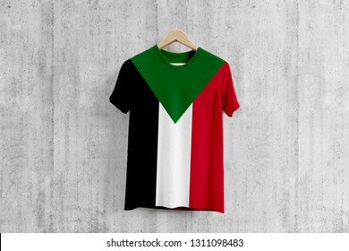 Sudan flag T-shirt on hanger, Sudanese team uniform design idea for garment production. National wear.