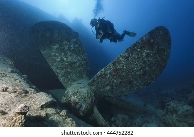 SUDAN, Red Sea, U.W. photo, Umbria wreck, a diver close to one of the propellers of the sunken ship - FILM SCAN