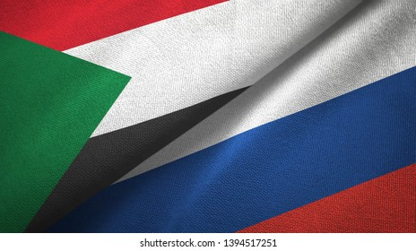 Sudan and Russia two flags textile cloth, fabric texture