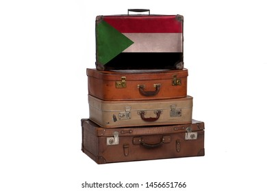 Sudan, Sudanese travel concept. Group of vintage suitcases isolated on white background