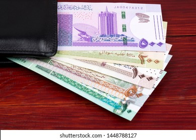 Sudanese pounds in a black wallet